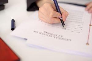 person filling out estate planning documents